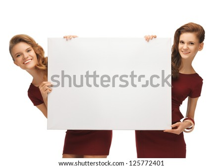 picture of two teenage girls in red dresses with blank board