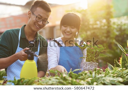 Picture of Two Young Chinese Florist Working in the Shop