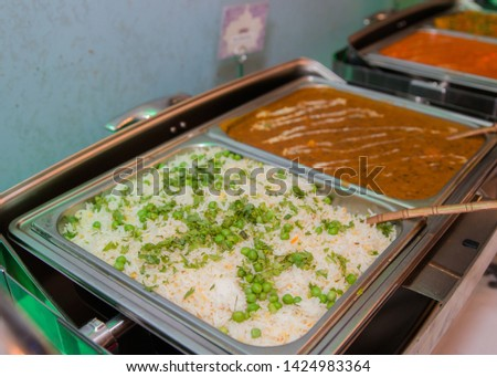 Picture of white rice with greens and Indian Chicken Curry