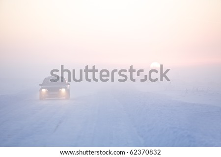 Picture of winter road and car in cold climate on sunset
