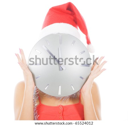 picture of woman in santa hat with big clock