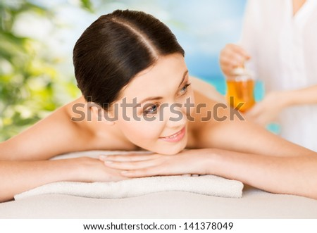 picture of woman in spa salon getting oil treatment