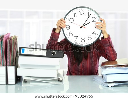 picture of woman with big clock covering her face