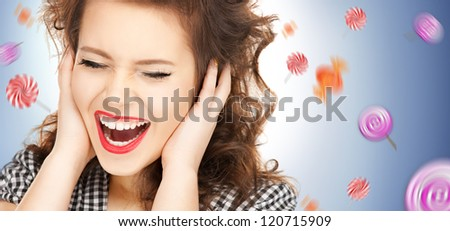 picture of woman with hands on ears and flying lollipops