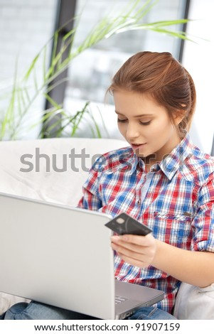 picture of woman with laptop computer and credit card