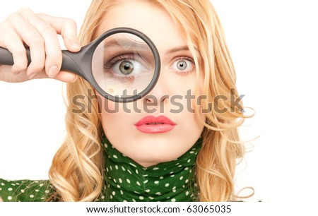 picture of woman with magnifying glass (focus on hand) - stock photo