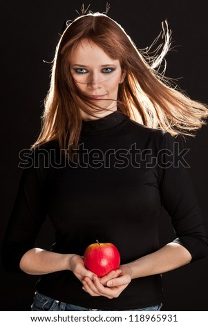Picture of woman with smoky-eyes make-up holding a red apple
