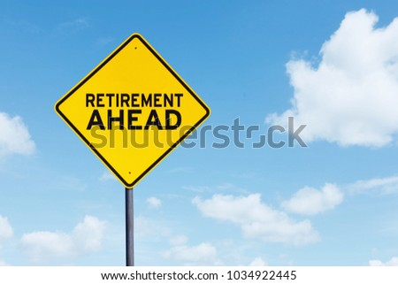 Picture of yellow highway sign with text of retirement ahead under blue sky