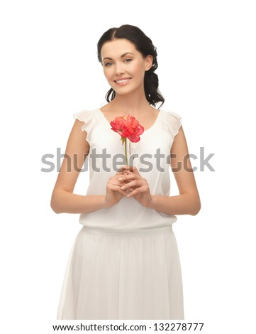 picture of young and beautiful woman with flower