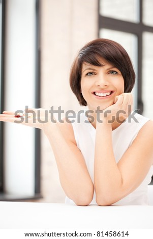 picture of young beautiful woman with pills - stock photo