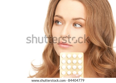 picture of young beautiful woman with pills