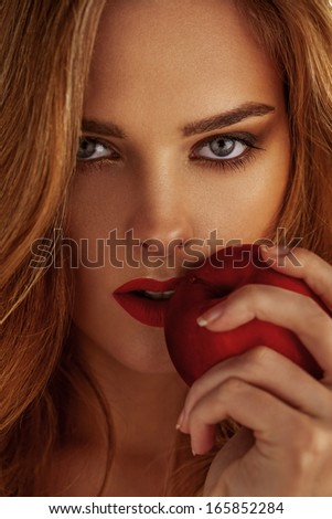 Picture of young beautiful woman with red apple