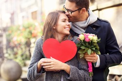 Picture of young couple with flowers and heart