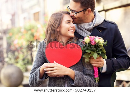 Shutterstock Picture of young couple with flowers and heart