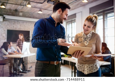 Picture of young designers using tablet in office