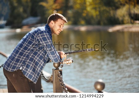 Picture of young fisherman fishing with rods