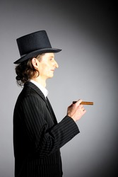 picture of young intelligent gangster man with cigar on red background