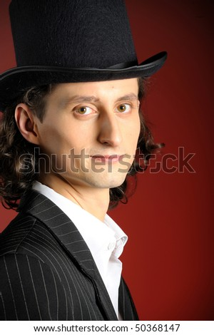 picture of young intelligent gangster man with cigare on red background