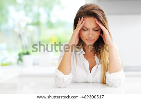 Picture of young sad woman in the kitchen Foto stock ©