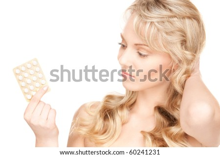 picture of young woman with pills over white