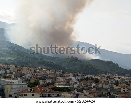 Picture present forest fire over the city in Croatia