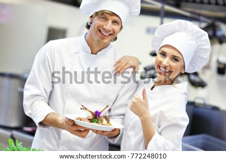Picture showing busy chefs at work in the restaurant kitchen