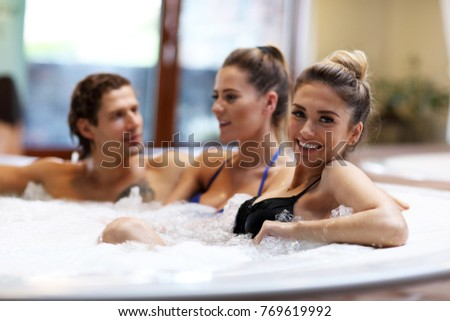 Photo of Picture showing group of friends enjoying jacuzzi in hotel spa