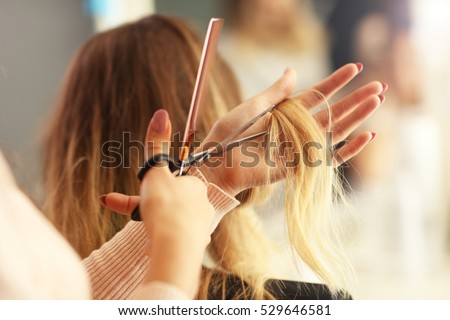 Picture showing hairdresser holding scissors and comb #529646581