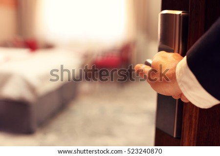 Picture showing hand of businessman opening hotel room #523240870