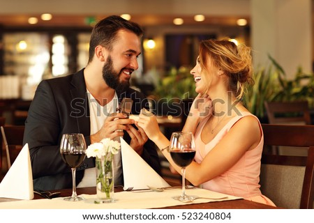 Picture showing young man proposing to beautiful woman