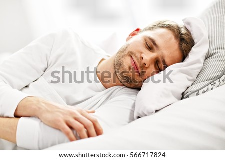 Picture showing young man sleeping in bed