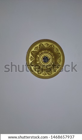 Picture taken from wall sealing, Design made in the centre of the sealing.