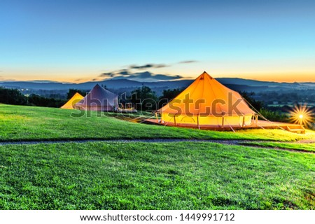 Picture tents during the sunset at the camp