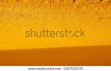 Picture Texture background yellow jaundiced xanthous silk fabric This medium/heavyweight faux silk fabric has a lovely sheen with slight color variations to give the appearance of slubs in the fabric #1567523176