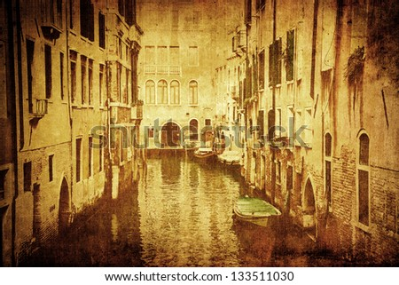 picture with a vintage grunge texture of a canal scene in Venice