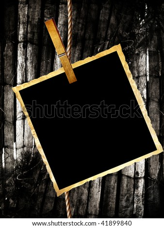 picture with clothes peg on a grunge background