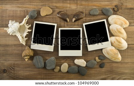 picture with cockleshells and stone on a wooden background