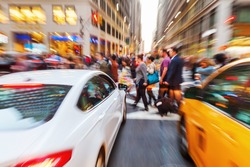 picture with creative zoom effect of a street scene with crossing people in Manhattan, New York City