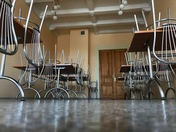 picture with tables and chairs in the school dining room, the chairs are built on the tables to be able to wash the floor