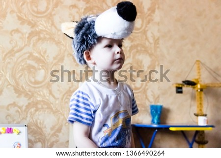 pictured in the photo A portrait of a little boy wearing a carnival suit of wolf