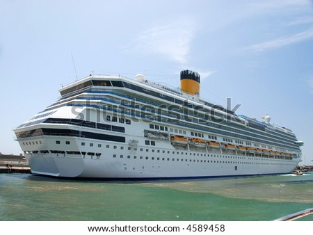 pictures of a cruise ship docked at the harbor