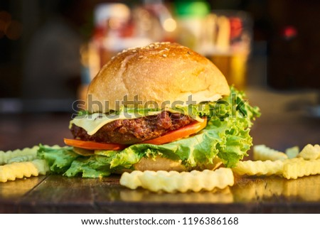 Pictures of delicious chicken burgers and chips
