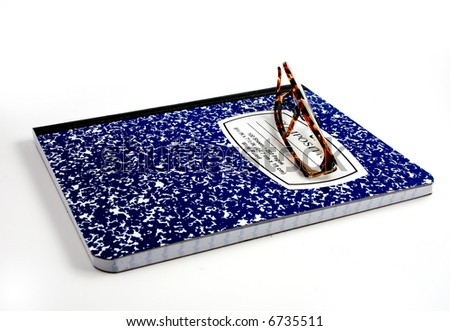 Pictures of glasses resting on a blank notepad, ready to write and work - stock photo