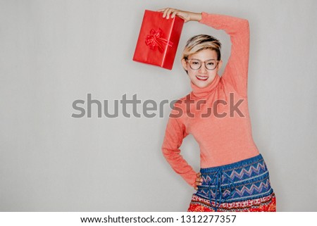 Pictures of smiles and happiness of Asian women when having gifts in her hands.focus on face