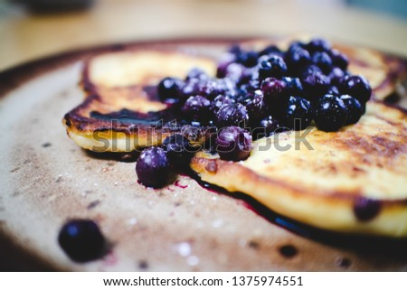 Pictures of tasty pancake and blueberries breakfast.