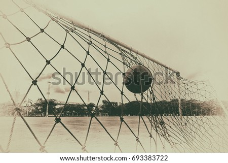pictures of the past  soccer ball in the net of the goal.