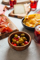 Pictures of typical Spanish food snacks (tapas). Composed of Sangria, iberian ham, manchego cheese and olives