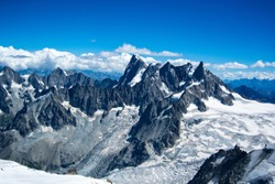 Pictures taken in Chamonix, Mont-Blanc, France, above 3000 meters altitude on a view point. Eternal snow, and hikers going for the summit.