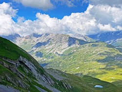 Picturesque and beautiful clouds over the Swiss mountain peaks and in the Uri Alps massif, Melchtal - Canton of Obwald, Switzerland (Kanton Obwalden, Schweiz)