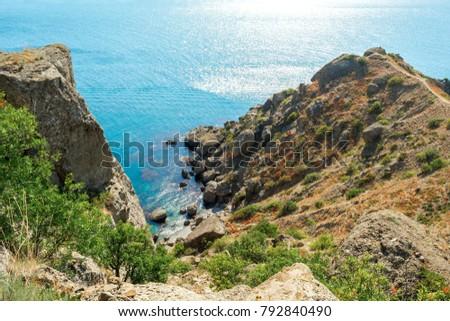 Picturesque and precipitous shore of the summer sea #792840490